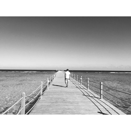 Railing Sea Clear Sky Horizon Over Water Water Pier Outdoors Full Length One Person Tranquil Scene Day Tranquility Scenics Fishing Pole Real People Standing Jetty Rear View Nature Wood Paneling Egypt Silvester EyeEmNewHere