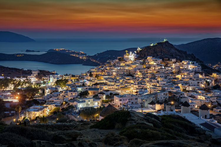 The town of Ios island, Chora, after sunset, Cyclades, Greece Aegean Sea Chora Dark Ios Greece Lights Architecture Bay Building City Cyclades Dusk Evening Greece High Angle View Illuminated Island Mountain Mountain Range Sky Sunset Tourism Town TOWNSCAPE Travel Destinations Water