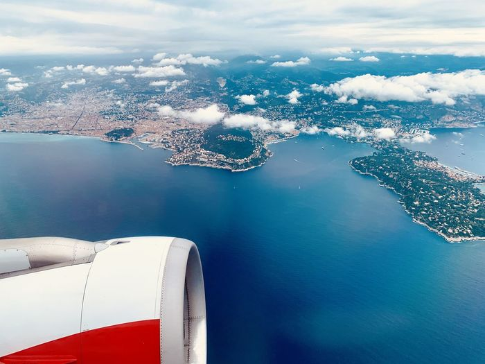 Departuring from Nice Cote d'Azur Water Transportation Mode Of Transportation Sea Cloud - Sky Air Vehicle Airplane Nature Travel Scenics - Nature Flying Aerial View No People Beauty In Nature Day Nautical Vessel Sky Outdoors Engine Jet Engine Luxury Côte D'Azur Nizza Nice Austrian Airlines