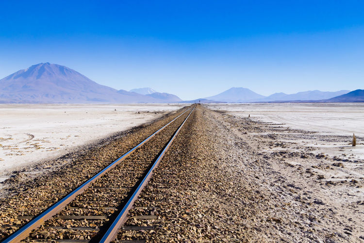 Train tracks perspective view, Salar de Colchani, Bolivia Sky Clear Sky Track Rail Transportation Railroad Track Environment Landscape vanishing point Transportation Diminishing Perspective Scenics - Nature Day No People Nature Land Beauty In Nature Tranquil Scene Arid Climate Climate Train Bolivia Bolivian Salar De Colchani Salt Flat