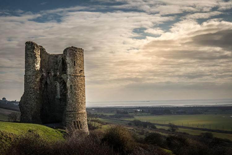 Hadleigh castle on field against cloudy sky