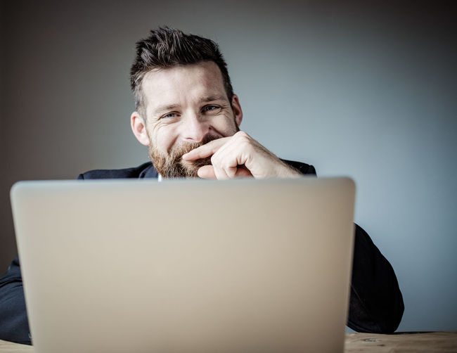 Portrait of man using smart phone