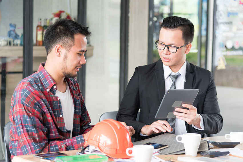 Business Business Person Businessman Businesswear Coffee - Drink Coffee Cup Communication Cooperation Corporate Business Digital Tablet Eyeglasses  Holding Indoors  Men Mid Adult Men Occupation Office Sitting Table Teamwork Technology Togetherness Two People Wireless Technology Working