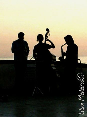 Music Musical Instrument Arts Culture And Entertainment Musician Adults Only Performance Jazz Music Saxophone Bass Guitar España Espanha Cities City Reflexão  People Nature Beach Vacations Sunset Viagem Beauty In Nature
