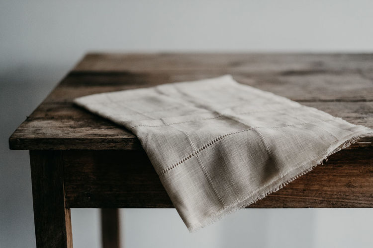 Close-up of paper on wooden table