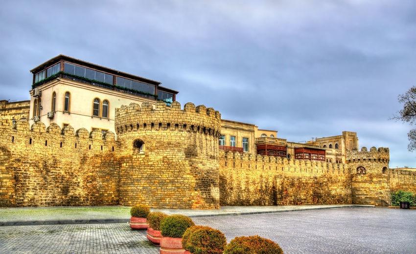Historic building against cloudy sky