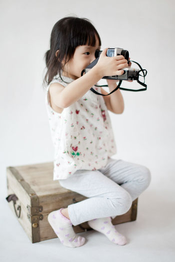 Camera Casual Clothing Front View Full Length Having Fun Holding Kidsphotography Leisure Activity Lifestyles Pastel Colors Pastel Power Person Polaroid Portrait Qq Studio Shot Taking Photos The Portraitist - 2016 EyeEm Awards