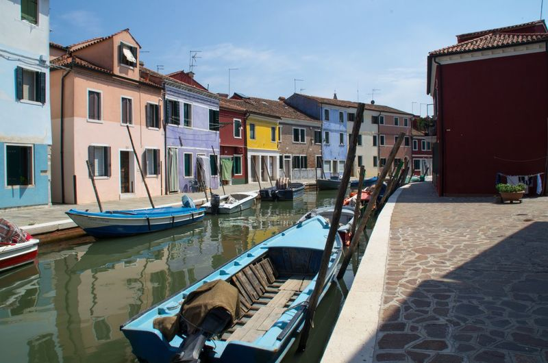 Architecture Boat Building Exterior Built Structure Burano Canal Canals And Waterways City Colourful Day Italy Nautical Vessel No People Outdoors Painted Houses Sky Travel Venice Venice, Italy Water