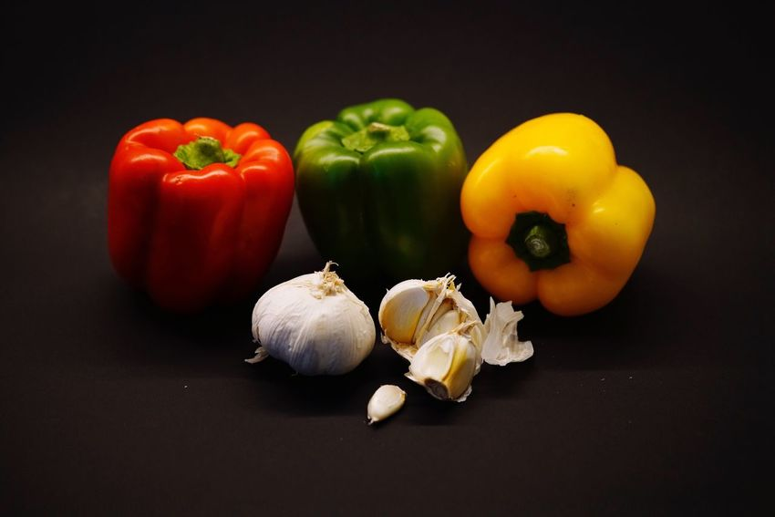 Vegetable Bell Pepper Food And Drink Food Still Life Red Bell Pepper Healthy Eating Yellow Bell Pepper Freshness Green Bell Pepper Garlic Raw Food Studio Shot Table No People Indoors  Black Background Close-up Tomato Red