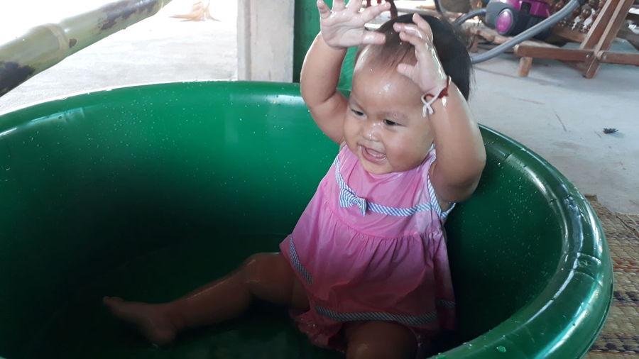 Cute Girl Playing In Tub