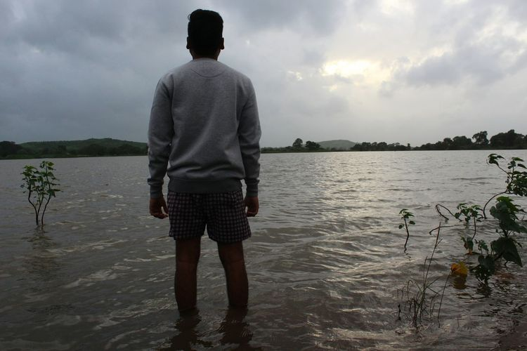 Water Lake Rear View Cloud - Sky Young Adult Adult One Person People Full Length Standing Walking One Young Man Only Young Men Tranquility One Man Only Only Men Sky Water's Edge Adults Only Nature Rural Scene Its Me Eyeem India Taking Photos EyeEm