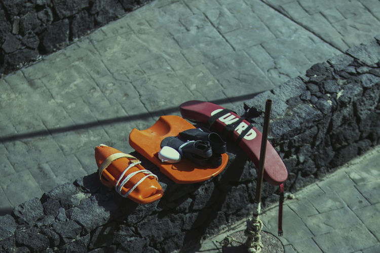 High angle view of shoes on stone wall