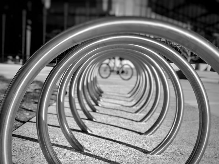 Blurred focus, circular ring bike rack, black & white photo Blackandwhite Pattern Architecture Circle Built Structure Geometric Shape Spiral Shape Metal No People Bicycle Design Outdoors Day Selective Focus City High Angle View Sunlight Nature Focus On Foreground In A Row My Best Photo Streetwise Photography The Art Of Street Photography My Best Photo Springtime Decadence The Mobile Photographer - 2019 EyeEm Awards The Minimalist - 2019 EyeEm Awards