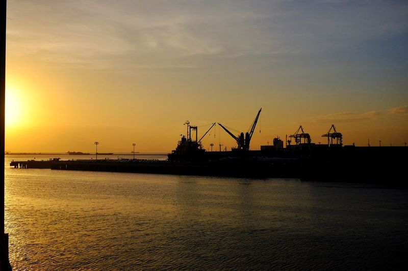 City Sunset Industry Crane - Construction Machinery Water Waterfront Sea Silhouette Sky Crane Freight Transportation Offshore Platform Outdoors Oil Industry No People Harbor Nature Tranquility Commercial Dock Shipping  Scenics Eyeem Philippines Eyeem Philippines Album The Great Outdoors - 2017 EyeEm Awards Philippines
