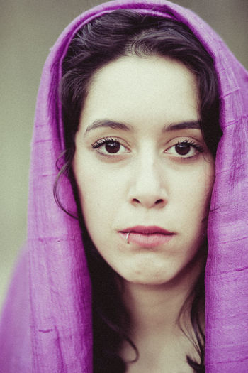 Close-up portrait of young woman wearing headscarf
