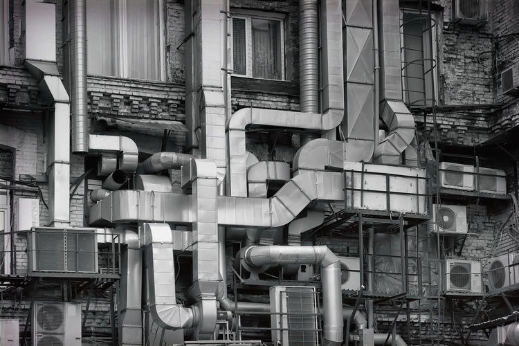 Low Angle View Of Pipes On Industrial Building