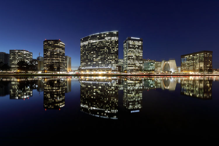 Oakland skyline panoramic view with Lake Merritt Reflections at blue hours. Oakland, Alameda County, California, USA. Building Exterior Architecture Built Structure City Illuminated Reflection Night Water Sky Office Building Exterior Waterfront Skyscraper Building Urban Skyline Cityscape Modern Clear Sky No People Tall - High Outdoors Financial District  Oakland Lake Merritt San Francisco Bay Area California