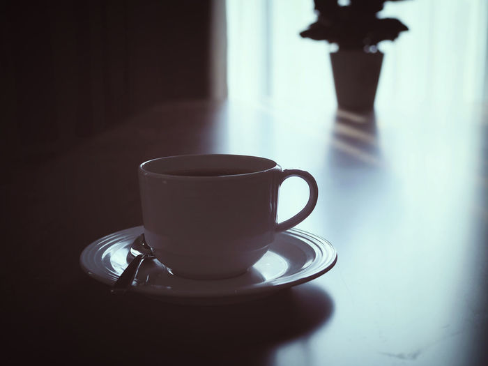 Close-up Coffee Coffee - Drink Coffee Cup Crockery Cup Day Drink Food And Drink Freshness Hot Drink Indoors  Mug No People Refreshment Saucer Shadow Still Life Sunlight Table Tea Cup