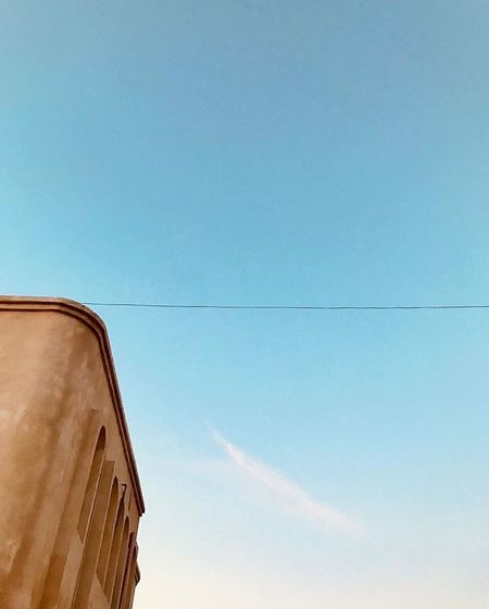 Arabian Moment Sky Architecture Built Structure Building Exterior Low Angle View Blue Day Industry Residential District High Section Sunlight Building Outdoors Wall - Building Feature No People Directly Below Copy Space Clear Sky Roof Nature