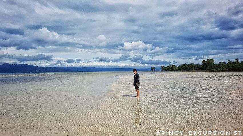 Lost in paradise! One Person Sand Sky Nature Beach Beauty In Nature Cloud - Sky One Man Only Samsungphotography Galaxys4 Mobilephotography Itsmorefuninthephilippines Travel Explore Love Philippines Cagbalete Quezonprovince Sea Hobbyist Photographer Sandbar Lowtide