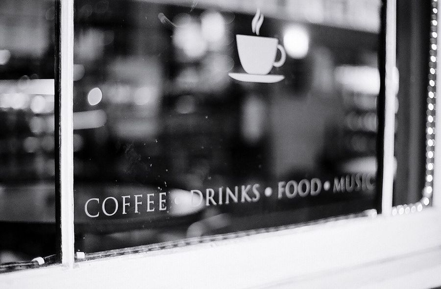 Blackandwhite Black And White Film Film Photography Focus On Foreground Window Text Close-up Cafe Coffee Reflection Reflections Reflection_collection Black & White Black Blackandwhite Photography Black And White Photography Black&white Blackandwhitephotography Black And White Collection  Blur England Chester Communication Indoors