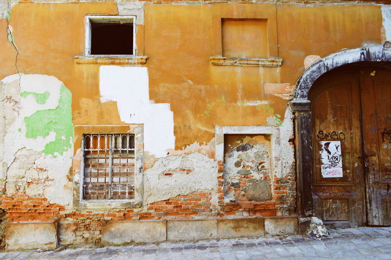 Street Streetphotography City Location Urban Urban Photography Bad Condition Ruined Decaying Decay Building Exterior Building Story Architecture Architectural Feature Window Architecture Building Exterior Built Structure Closed Door Historic Damaged Weathered Abandoned Run-down My Best Photo