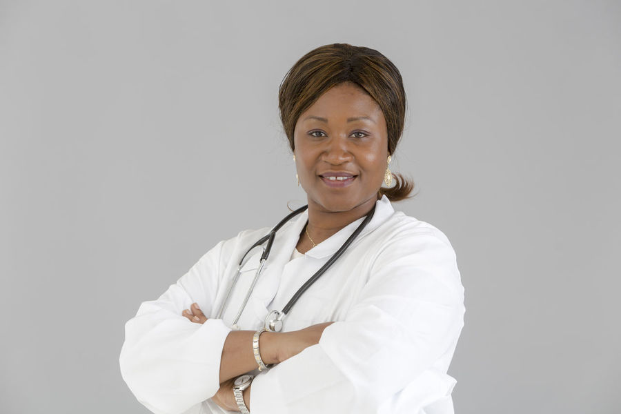 Reassure Smiling Self Confident Reassuring Posing Self Confidence Selfconfident Front View Reassurance Looking To The Camera Looking At Camera White Background Clinic Doctor  Nurse Pediatrics Hospital African Girl  African TrustPortrait Beautiful Woman Medical Pediatrician Stethoscope  EyeEmNewHere
