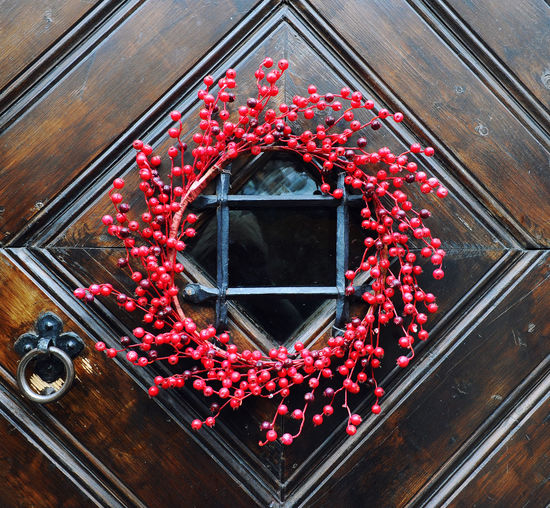 Decorated door close-up Circle Decor Doors Entrance Home Brown Close-up Decorated Decoration Decorations Decorative Door Door Handle Door Window Door Windows Door Wood Doorway Flower House No People Outdoors Red Window