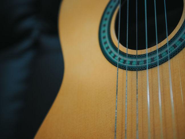 Classical guitar over dark background Classical Music Copy Space Guitarra Performer  String Classical Guitar Guitar Guitar Love Guitar Player Guitar String Guitar Strings Guitarist Guitars