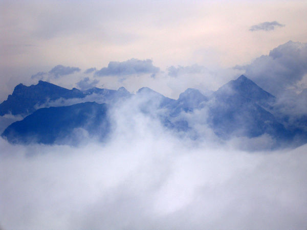 European Alps Beauty In Nature Cloud - Sky Cloudscape Cold Temperature Day European Alps Fog Heaven Landscape Low Angle View Mountain Mountain Range Nature No People Outdoors Scenics Sky