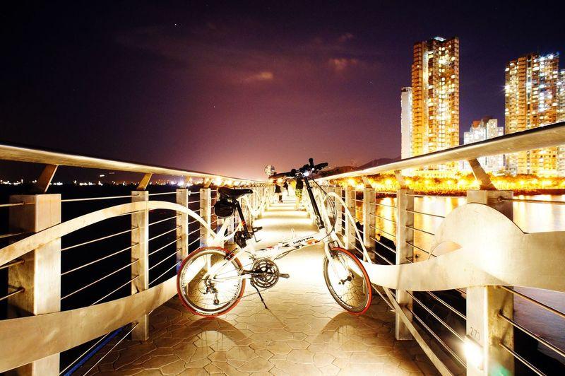 Illuminated bridge against sky in city at night