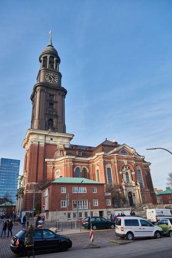 HAMBURG, GERMANY - MARCH 26, 2016: Tourist visit Cathedral of St Michaelis Blue Sky Cathedral Hamburg K Landmark M St. Michael Tourist Tranquility