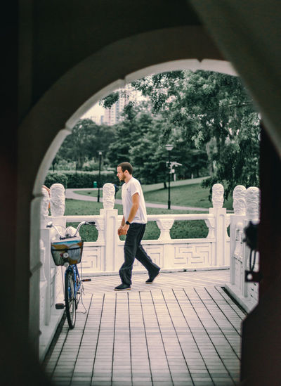 Side view of man standing at archway