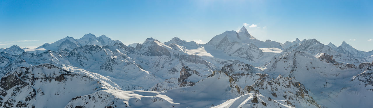 Panorama of the Weisshorn and surrounding mountains in the swiss alps. Mountain Sky Beauty In Nature Cold Temperature Winter Scenics - Nature Snow Mountain Range Environment Nature Panoramic Landscape Day Idyllic Blue Mountain Peak Formation Range Switzerland Weisshorn Architecture Swiss Alps