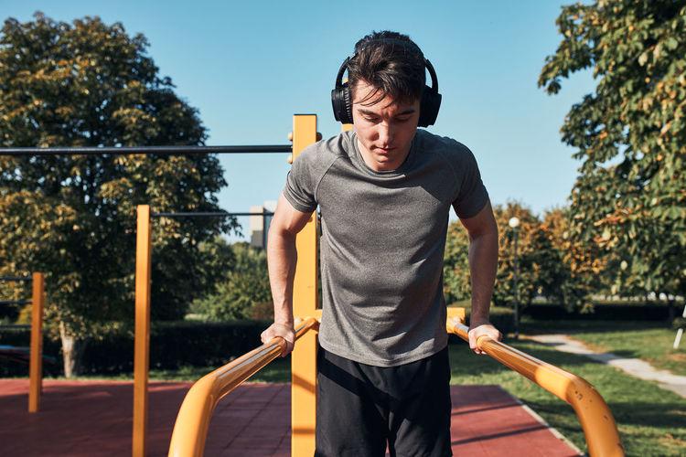 Young man exercising at park