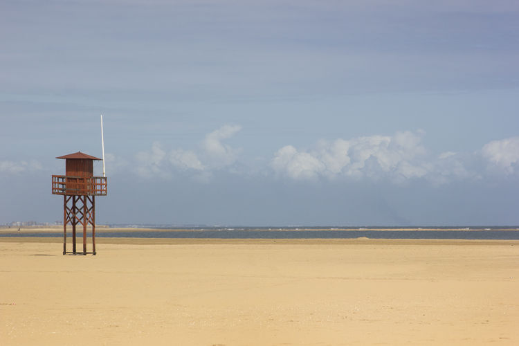 Lifeguard Hut On Beach Against Sky