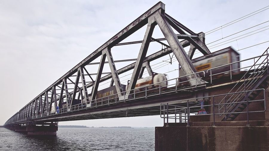 Your order is being delivered Bridge - Man Made Structure Transportation Bridge Architecture Built Structure Connection Water Low Angle View Outdoors Metal Travel Day Economy