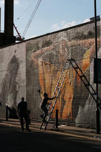 Artist Silhouette Day Outdoors Streetphotography Graffiti Shoreditch, London Street Art Graffiti Art Painting