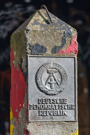 DDR Grenzpfahl #1 DDR Germany Wende Border Historic German Flag Checkpointcharlie Memorial Close-up Military