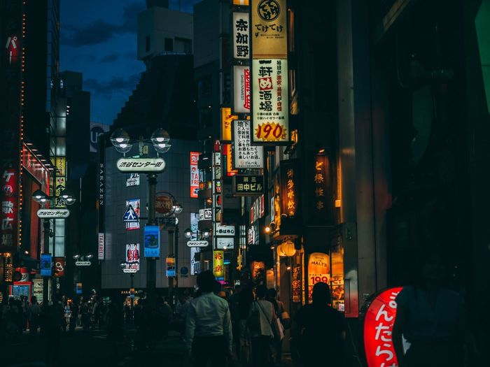 Night Nightphotography Japan Photography Japan Tokyo Streetphotography City Illuminated Building Exterior Built Structure Communication Architecture Text City Life Street Script Commercial Sign Large Group Of People Real People Advertisement Non-western Script Group Of People Crowd Road Sign Night