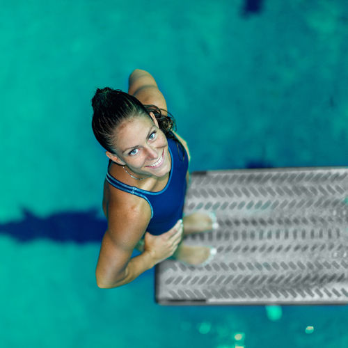 Female Diver Jumping Into The Pool Diving Diver Swimming Pool Water Sport Woman Jumping Female Jump Wet Diving Board Board Above Action Extreme Sports Swimwear Water Sport Swim Active Training Exercising Muscular One Woman Only Pool Smiling