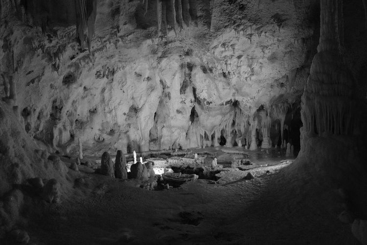 Candle Stalactite  Stalagmites Black And White Friday Cave Illuminated Nature Night No People Physical Geography Rock - Object Rock Formation