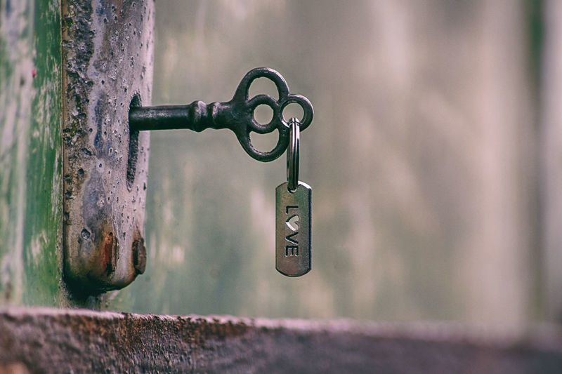Love is the key to happiness. Close-up Key Rusty Hanging Selective Focus Outdoors Lock Metal Door Entrance Love Friendship Vintage Vintage Style Padlock Keyhole Depth Of Beauty Fading Beauty Soft Colours Creative Photography Creativity CreativePhotographer Creative