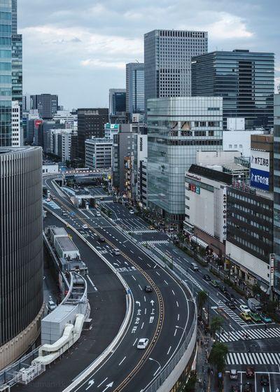 Tokyo, Japan, 2018. 7225 https://instagram.com/p/Bl5bXIolCRV/ EyeEm Gallery Japan Photography Architecture Building Exterior City Built Structure Transportation Mode Of Transportation Road Building Car