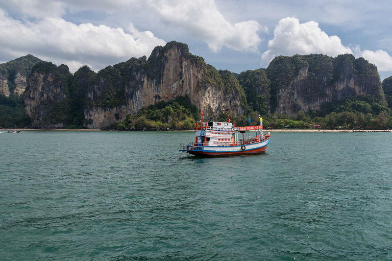 Krabi Krabi Thailand Beauty In Nature Cliff Cloud - Sky Day Luxury Mode Of Transportation Mountain Nature Nautical Vessel Outdoors Passenger Craft Rock Formation Sailing Scenics - Nature Sea Sky Tourism Transportation Travel Travel Destinations Water Waterfront