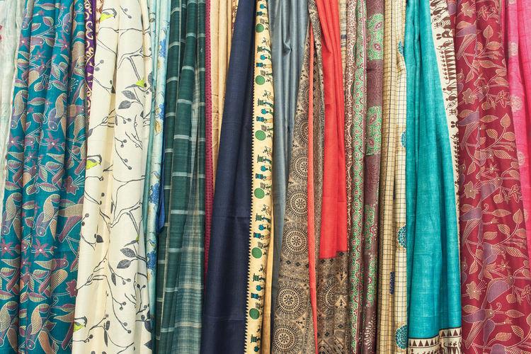 Indian sarees, with vibrant multicolor ethnic design and motifs. at saras mela, kolkata.