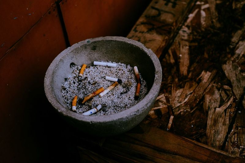 Close-up of cigarette on wood