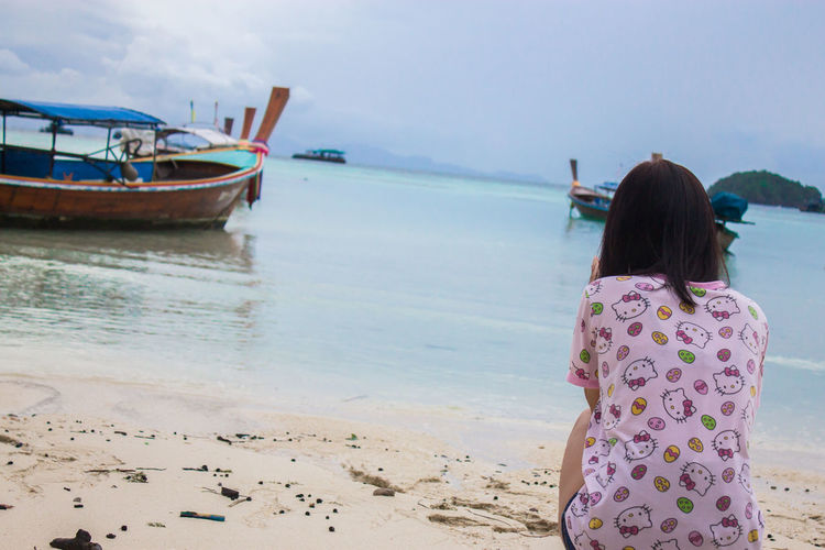 Sea Beach Beauty In Nature Day Females Girls Hair Hairstyle Land Leisure Activity Lifestyles Nature Nautical Vessel One Person Outdoors Real People Rear View Scenics - Nature Sea Sky Three Quarter Length Water Women