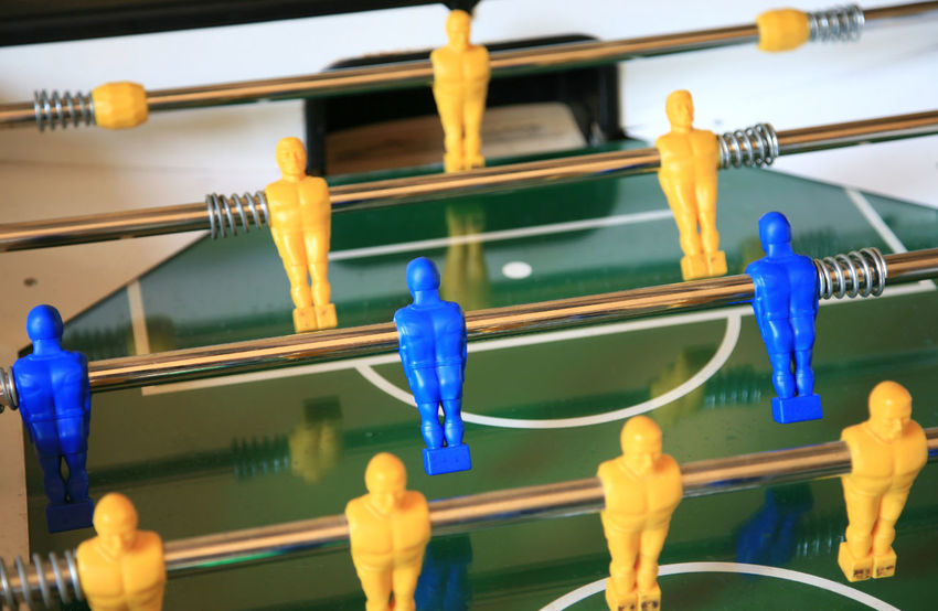 Detail of a tablesoccer game Fun Green Recreation  Tablesoccer Blue Close-up Day Game Hobby In A Row Leisure Games Play Playfield Soccer Tablefootball Team Water Yellow