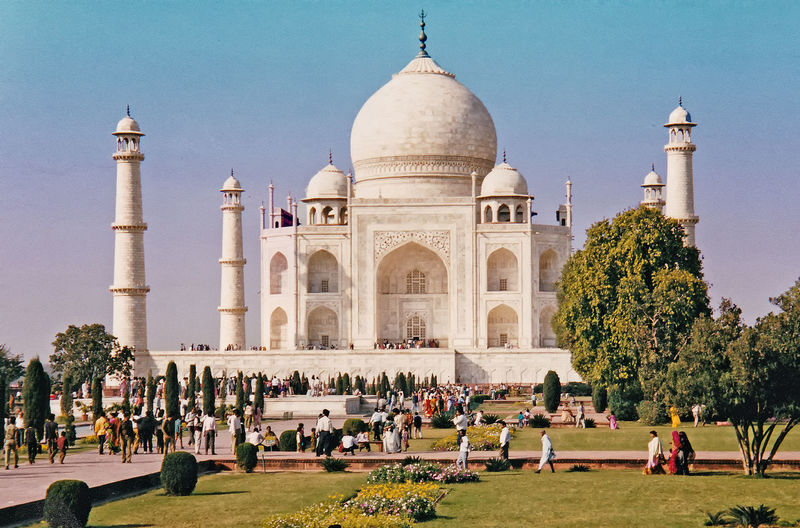The Taj Mahal Indian Culture And History Architecture People Nature Real People Men Sky Women Tree Travel Tourism Day History Outdoors Vacations Clear Sky Dome Lifestyles Travel Destinations Taj Mahal, Agra Large Group Of People Leisure Activity Building Exterior Built Structure Romantic Monument The Graphic City